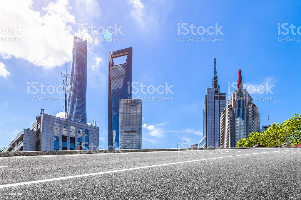 empty asphalt road with cityscape and skyline of Shanghai photo libre de droits