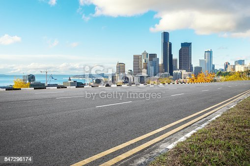 860403416istockphoto empty asphalt road with cityscape of modern city in blue sky 847296174