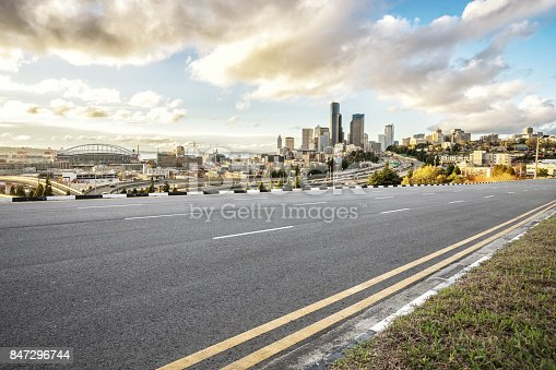 860403416istockphoto empty asphalt road with cityscape of modern city in blue sky 847296744