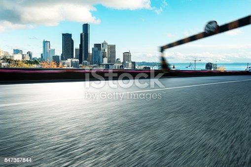 860403416istockphoto empty asphalt road with cityscape of modern city 847367844