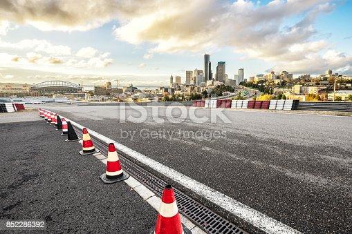 860403416istockphoto empty asphalt road with cityscape of modern city 852286392