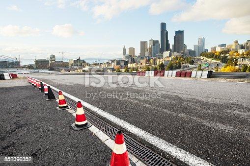 860403416istockphoto empty asphalt road with cityscape of modern city 852396352