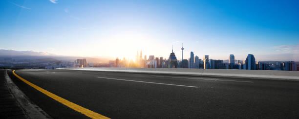 empty asphalt road with modern cityscape stock photo