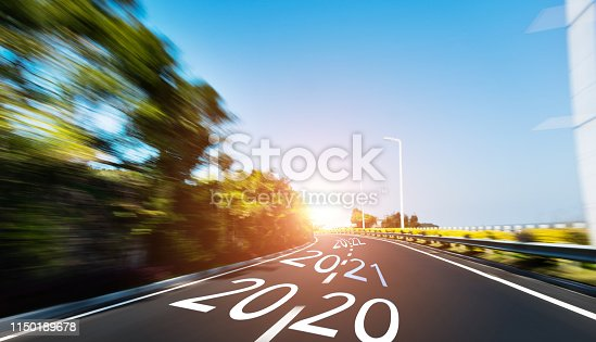 1150191246 istock photo Empty asphalt road with Number 2020, 2021, 2022 1150189678