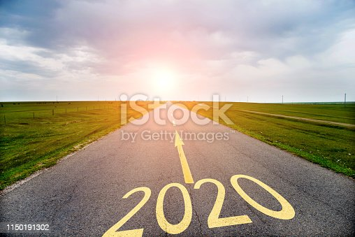 1150191246 istock photo Empty asphalt road with Number 2020 1150191302
