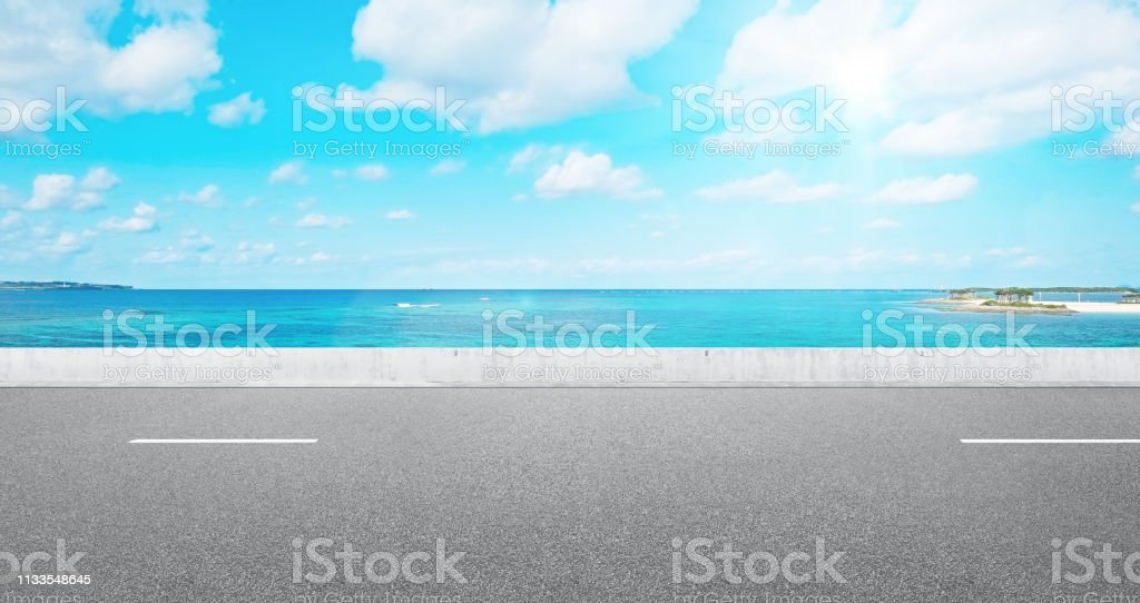 Business and design concept - empty asphalt road with panoramic sea...