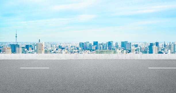 Empty asphalt road with tokyo skyline for mockup Business and design concept - Empty asphalt road with panoramic modern cityscape aerial view under bright blue sky of Tokyo, Japan for mockup horizon over land stock pictures, royalty-free photos & images