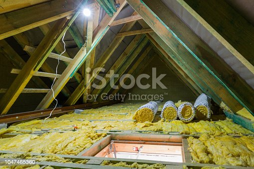 istock Empty attic in the house with mineral wool insulation 1047465360