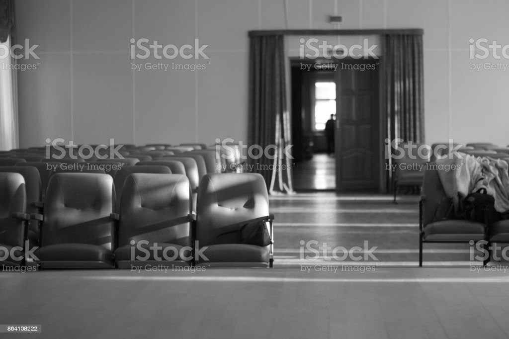 Empty auditorium with beige chairs, theatre or conference hall Black and white photo . royalty-free stock photo