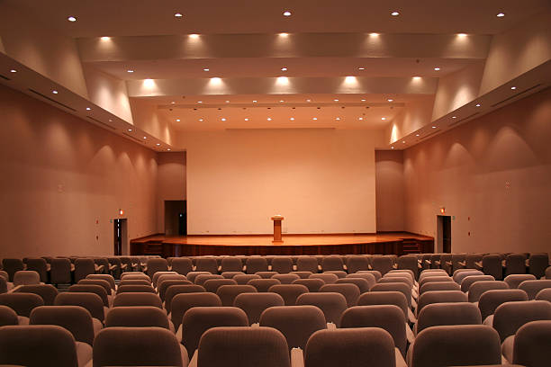 empty auditorium with grey seats and downlights - kongre merkezi stok fotoğraflar ve resimler