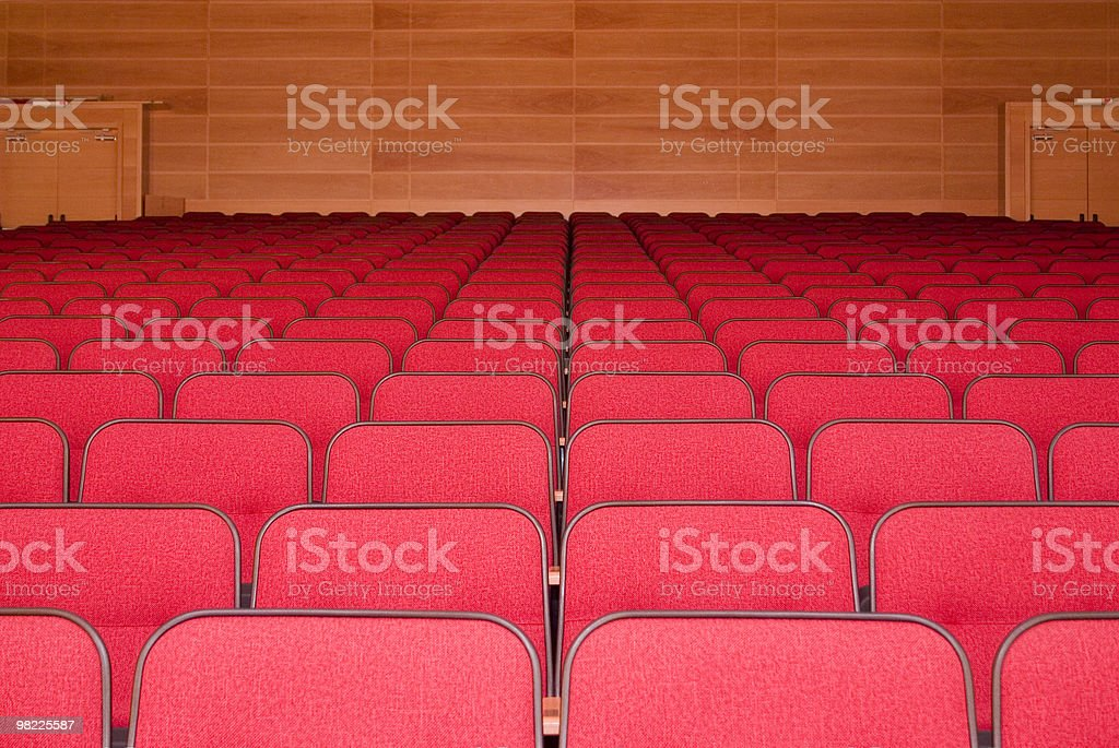 Empty auditorium with red seats royalty-free stock photo