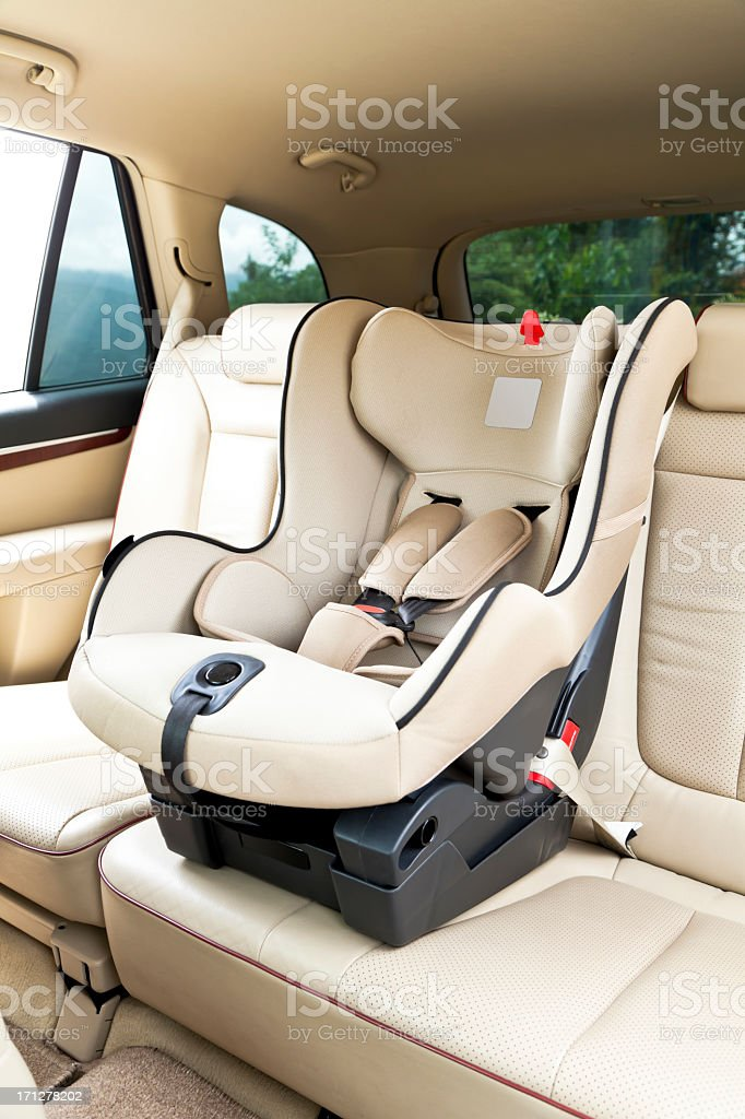 Empty baby car seat in the back of a car stock photo