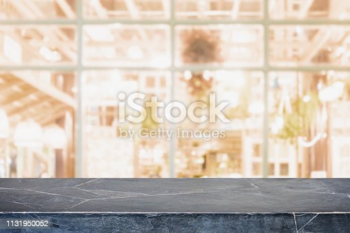 istock Empty background marble stone table top and blurred bokeh cafe and restaurent interior background with vintage filter - can used for display or montage your products. 1131950052