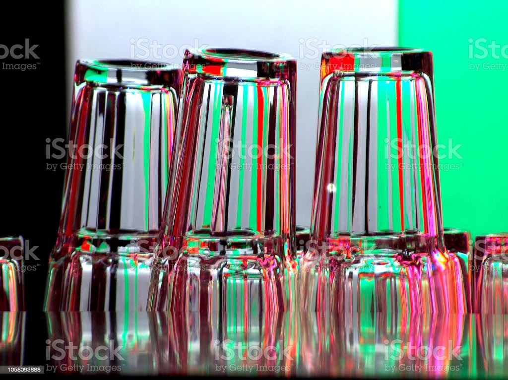 Empty bar glasses on color background. Waiting for drink. Joyful...