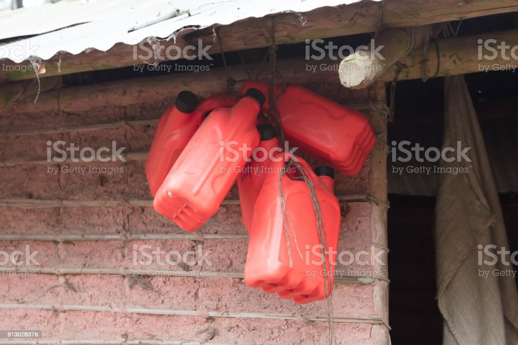 Empty barrels in an African village stock photo