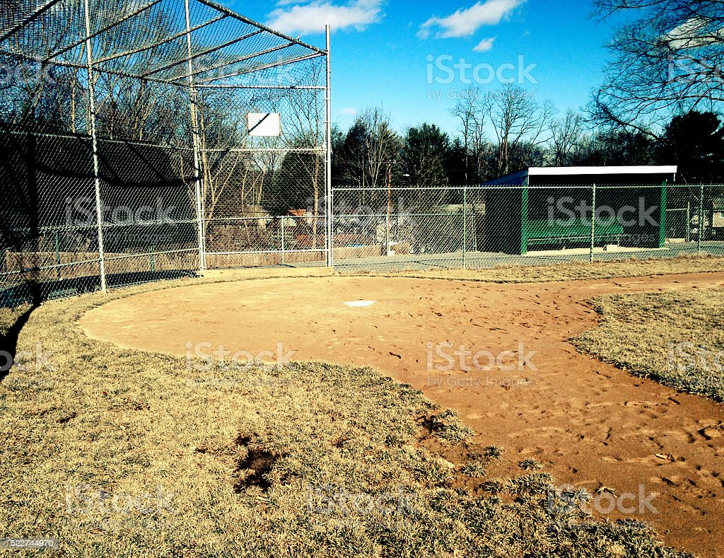 Empty baseball field during the winter stock photo