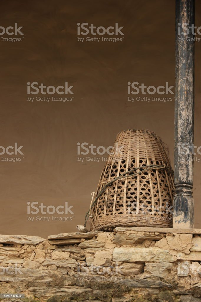 Empty basket on wall, Annapurna Range stock photo