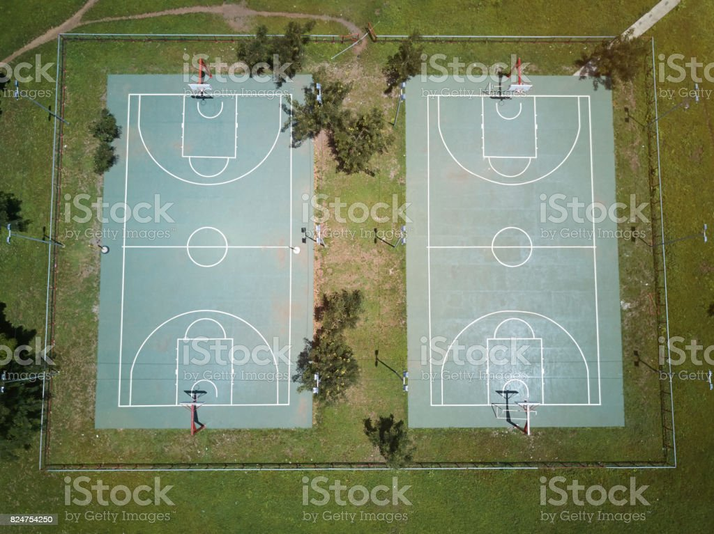 Empty basketball field aerial drone view in school park