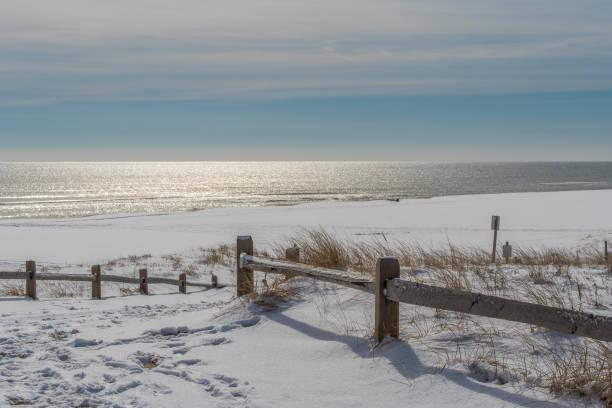 Empty beach after snowfall stock photo
