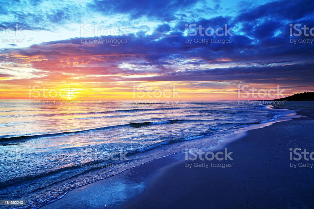 Empty Beach and Ocean during Sunset stock photo