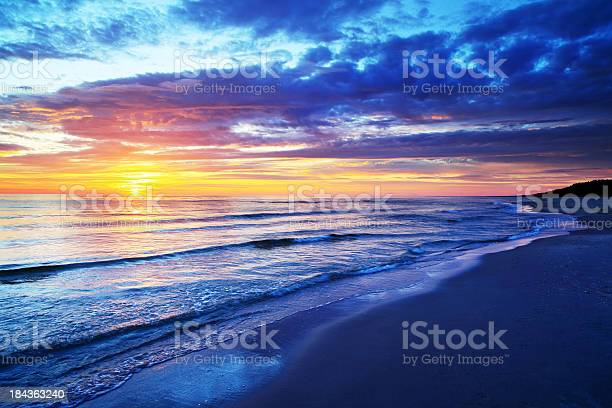 Empty Beach And Ocean During Sunset Stock Photo - Download Image Now