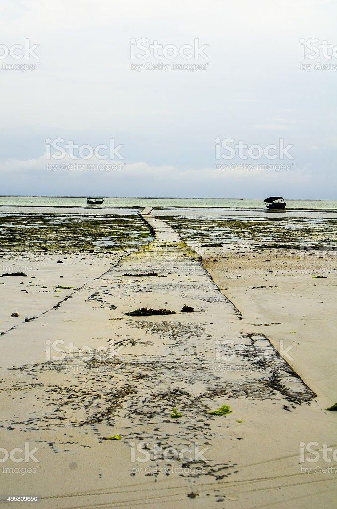 Empty beach walk Zanzibar royalty-free stock photo