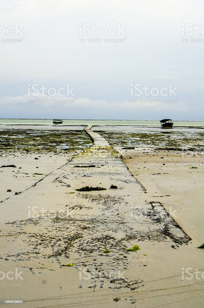 Empty beach walk Zanzibar stock photo