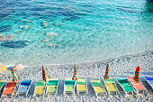 Empty beach with closed umbrellas on italian beach