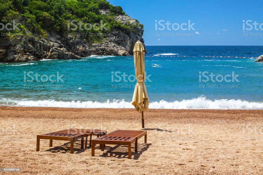 Empty beach with two chairs, Queen's Beach, Montenegro stock photo