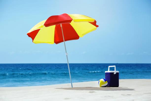 Empty beach with umbrella sea accesorries
