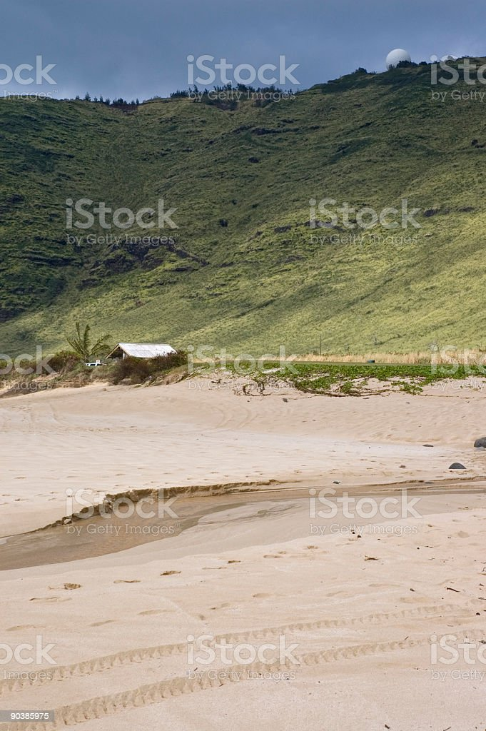 Empty beach with view of a hill stock photo