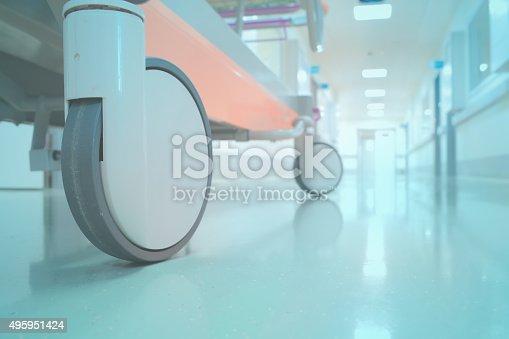 629429900istockphoto Empty bed in hospital corridor perspective 495951424
