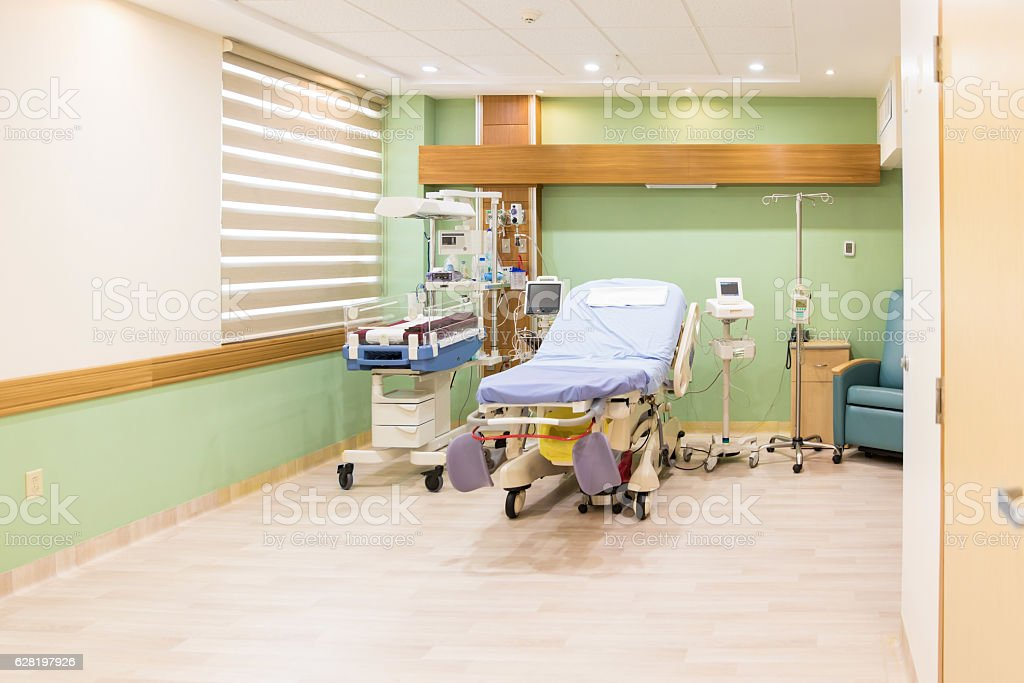 Empty bed in maternity ward at a hospital stock photo