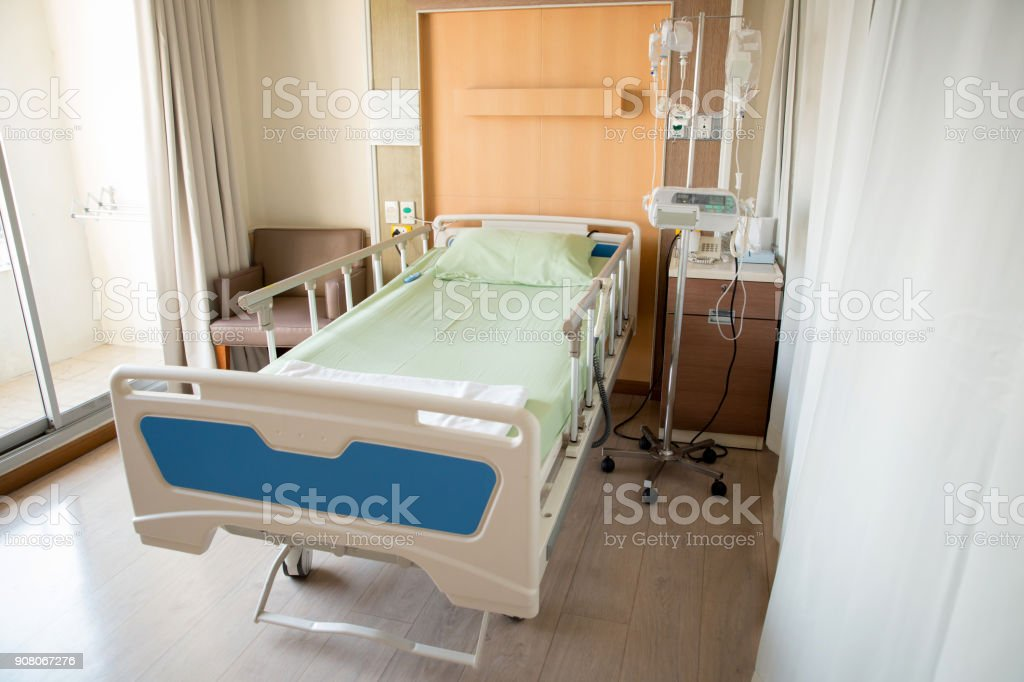 Empty bed in the modern hospital room. deluxe private ward. equipped...