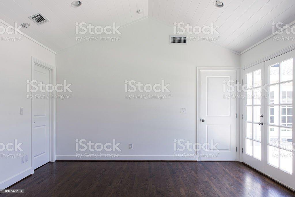 Empty bedroom with wooden floors