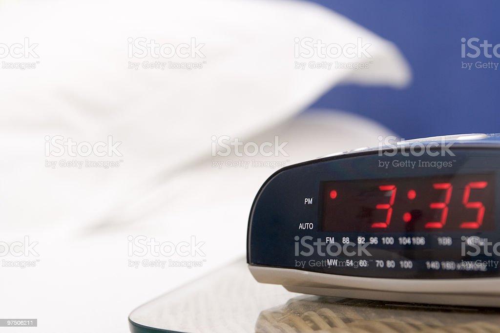 Empty bedroom with alarm clock royalty-free stock photo