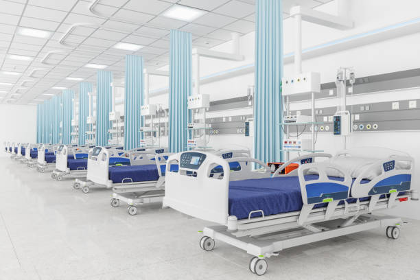 Empty beds in a hospital ward Empty beds in a hospital ward life support machine stock pictures, royalty-free photos & images