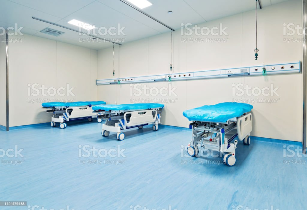 Empty beds in hospital ward.