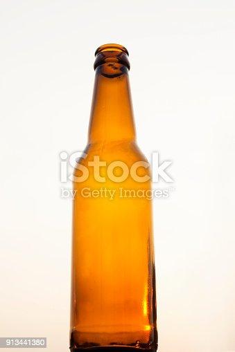 1073474208istockphoto Empty beer bottle isolated 913441380