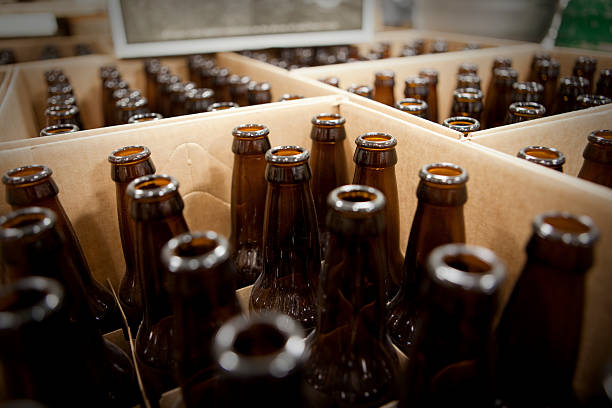Empty beer bottles waiting to get filled. stock photo