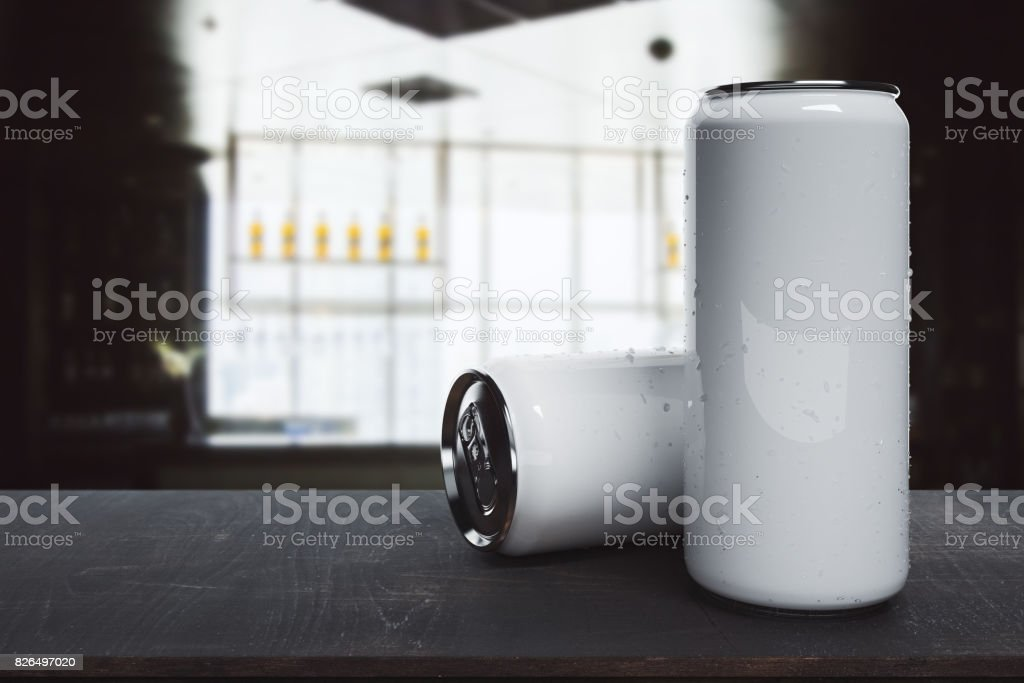 Empty beer cans on blurry background stock photo