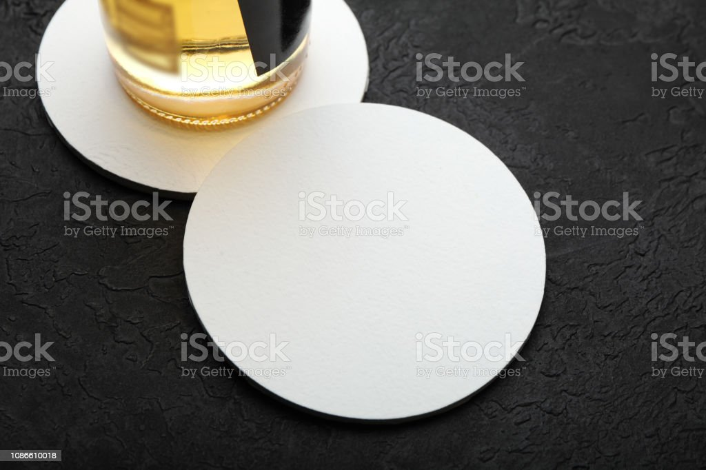 Empty beer coaster for bar. Space for drink log stock photo