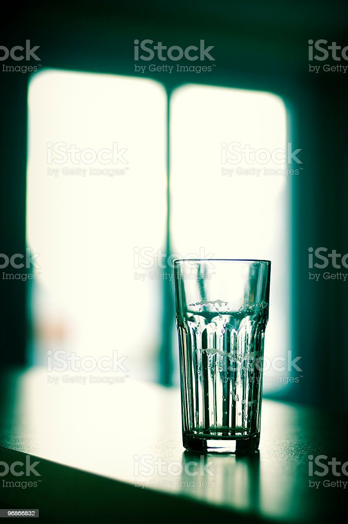 Empty Beer Glass, Cross-Processed royalty-free stock photo