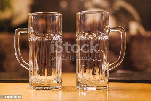 1144550840istockphoto Empty beer glasses 1145885349