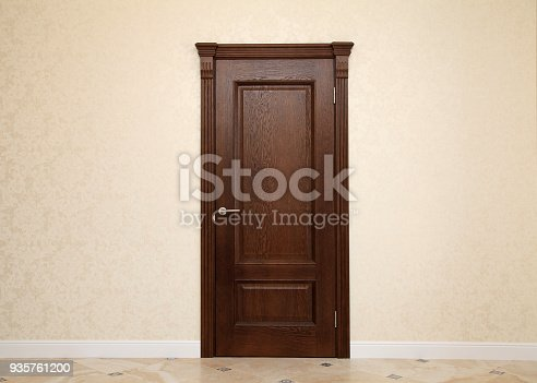empty beige room interior with brown wooden door and copy space