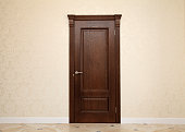 empty beige room interior with brown wooden door