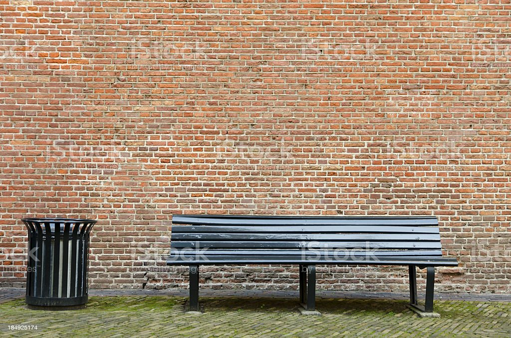 Empty bench and garbage bin stock photo