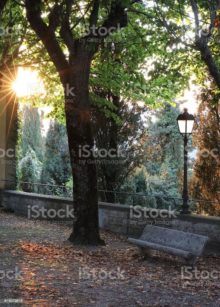 Empty bench at dusk in Radda, Tuscany, Italy stock photo