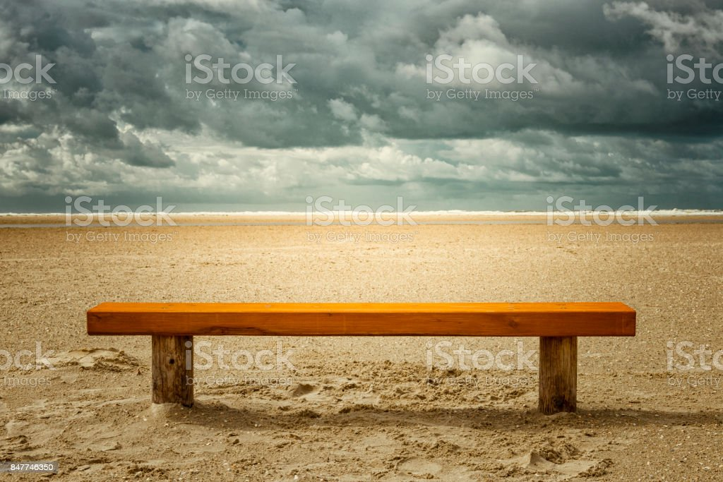 empty bench at the beach stock photo