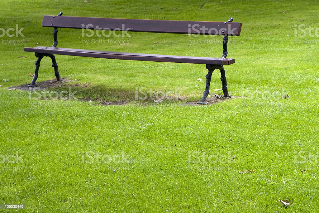 Empty bench in a park royalty-free stock photo